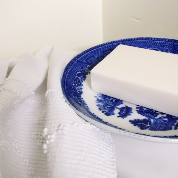 using a vintage saucer as a soap dish