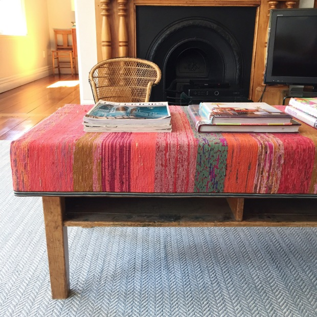 coffee table upholstered with a recycled sari woven rug